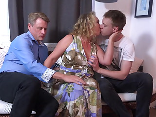 Dad and young gentleman sharing mature mother